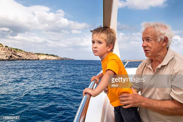 Grandfather With Grandson On A Boat Trip