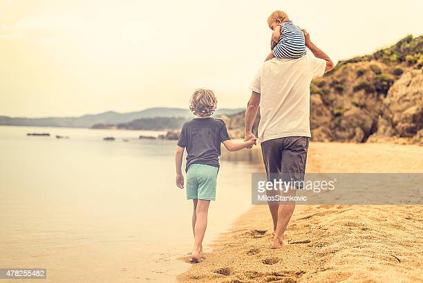 Grandfather with his grandchildren at the beach