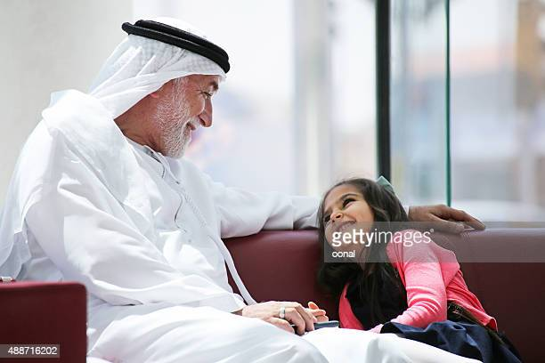 grandfather with his granddaughter - arabia stock pictures, royalty-free photos & images
