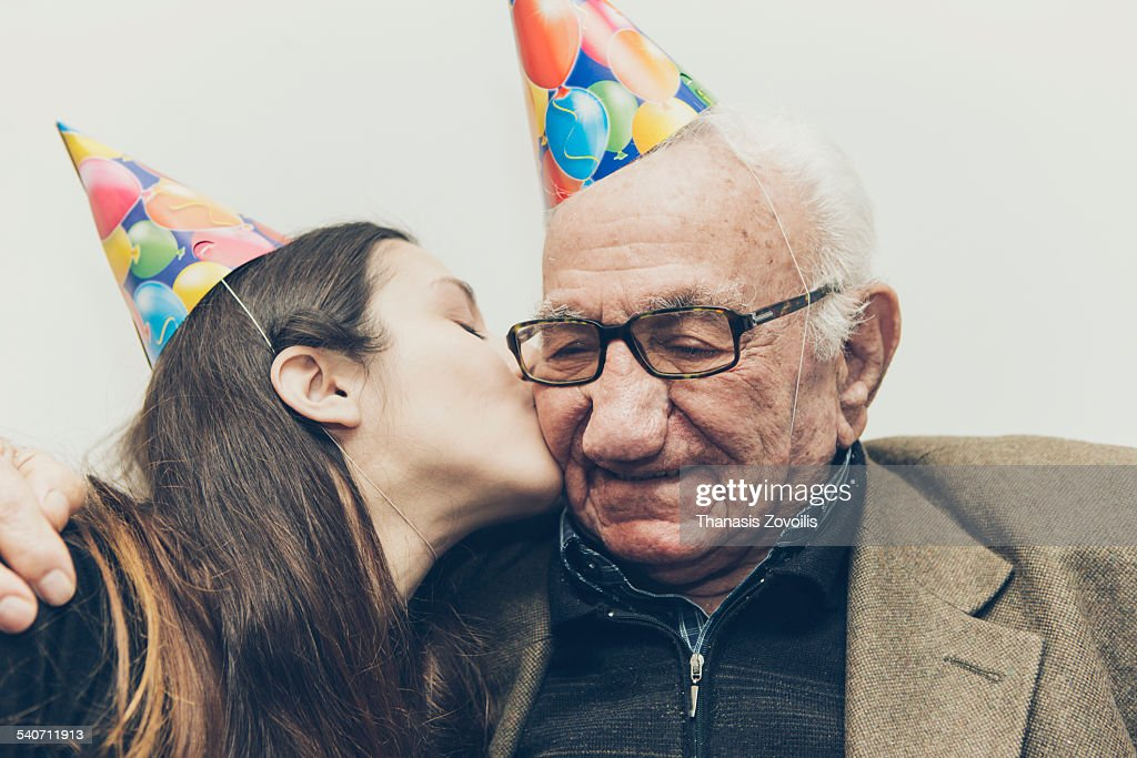 Grandfather with his granddaughter : Stock Photo