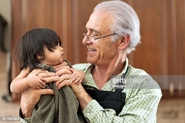 grandfather with his granddaughter - stepfamily stock photos and pictures