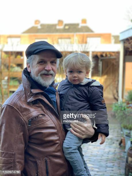 grandfather with his grandson - northern european descent stock pictures, royalty-free photos & images