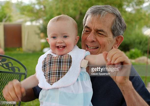 Grandfather with one year old at picnic