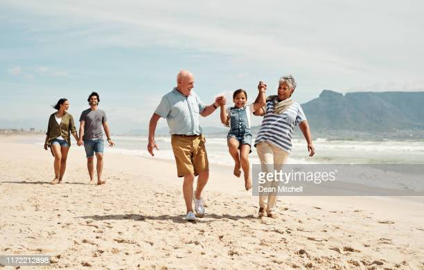 grandkids keeps the heart young - multi generation family stock pictures, royalty-free photos & images
