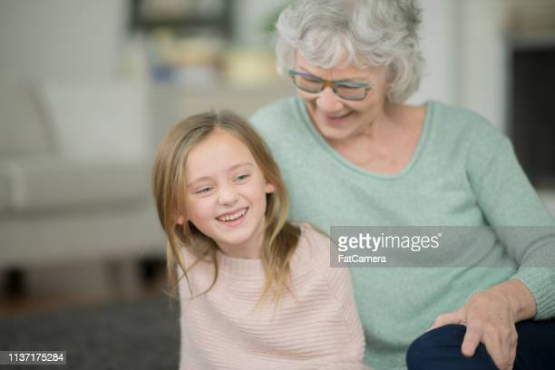 grandma and granddaughter laughing - fat granny stock pictures, royalty-free photos & images
