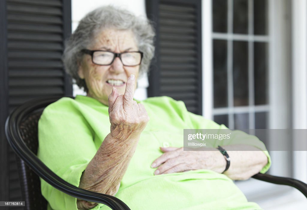 Grandma Flipping the Bird From Her Front Porch : Stock Photo