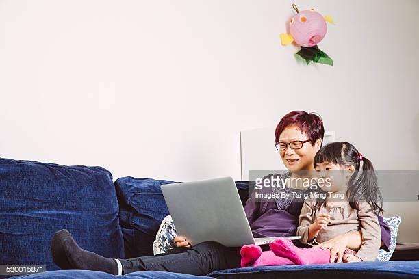 Grandma $ grand daughter using laptop