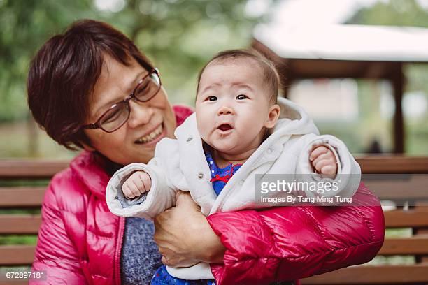 Grandma holding grandchild joyfully