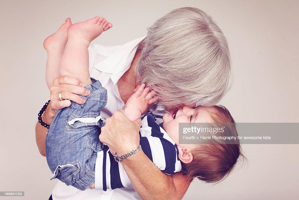 Grandma hugging child : Stock Photo