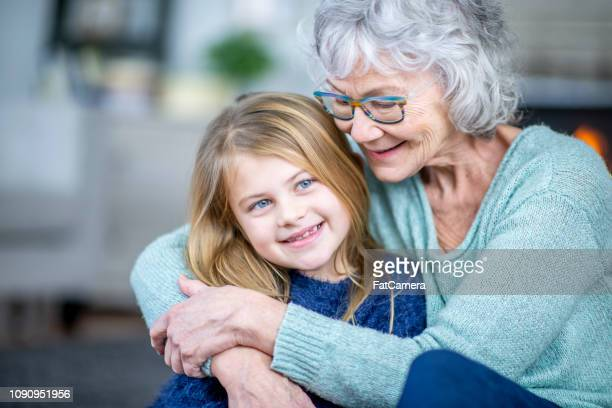 grandma hugging girl - fatcamera stock pictures, royalty-free photos & images