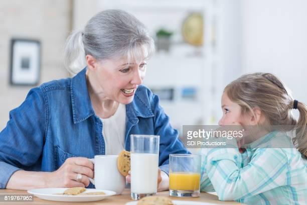 Grandma talks with granddaughter after school