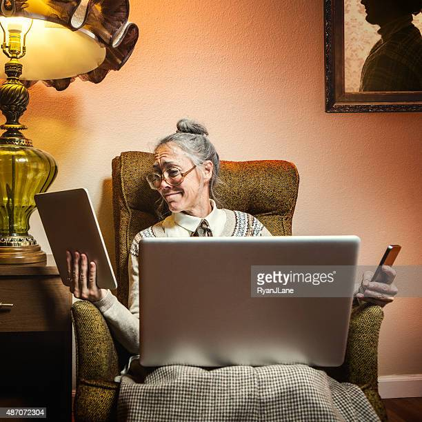 Grandma Using Multiple Modern Electronics