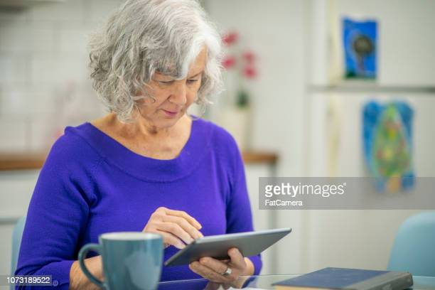grandma using technology - fatcamera stock pictures, royalty-free photos & images