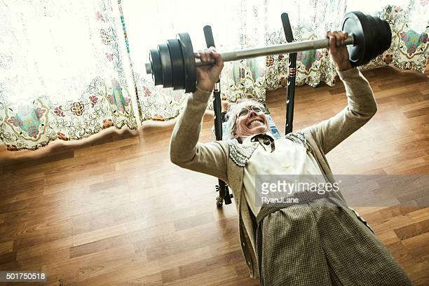 grandma weightlifting in living room - female bodybuilder stock pictures, royalty-free photos & images