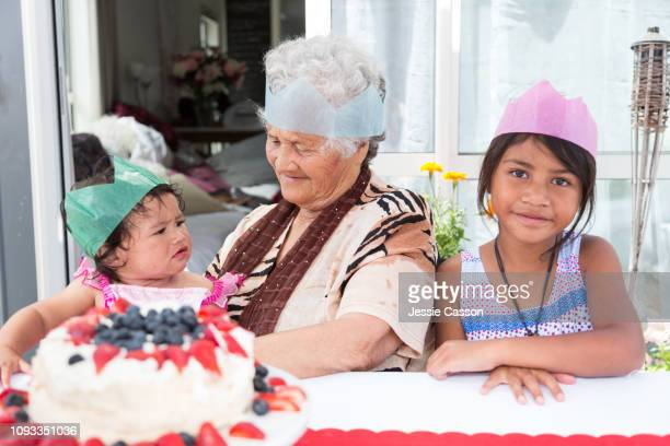 Grandma with granddaughters waiting to eat pavlova