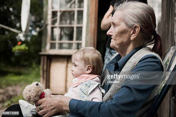grandma with handicapped child - latvia stock pictures, royalty-free photos & images