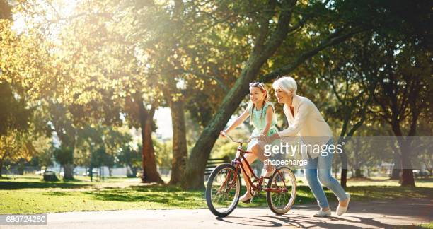 grandma's are short on criticism & long on love - public park stock photos and pictures
