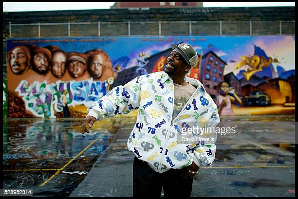 GrandMaster Caz photographed next to The Graffiti wall of Fame in Harlem