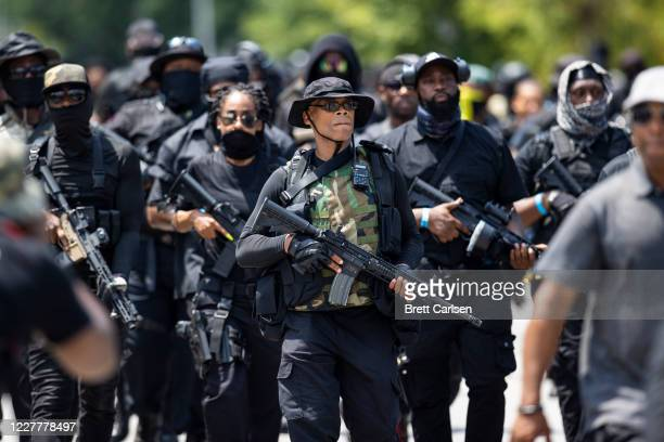 Grandmaster Jay leader of NFAC leads a march of his group and supporters on July 25 2020 in Louisville Kentucky The group is marching in response to...