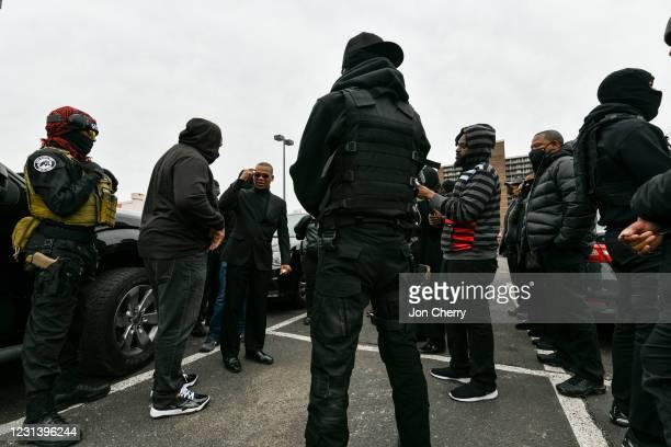 Grandmaster Jay, leader of the NFAC, speaks with NFAC members in a parking lot in the Old Louisville neighborhood on February 26, 2021 in Louisville,...