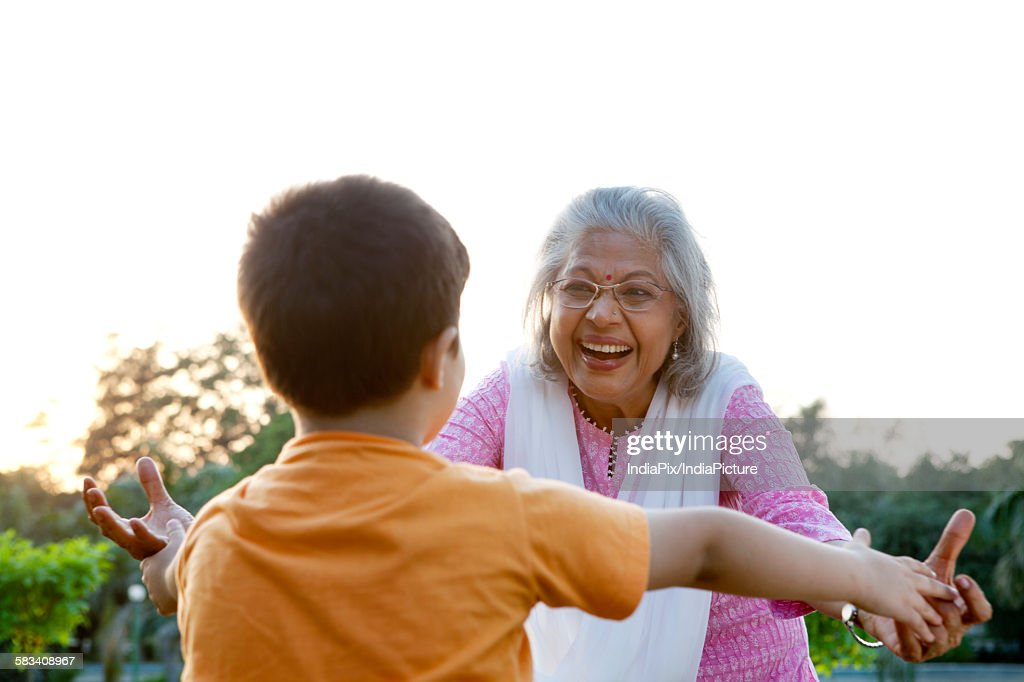 Grandmother about to hug grandson : Stock Photo
