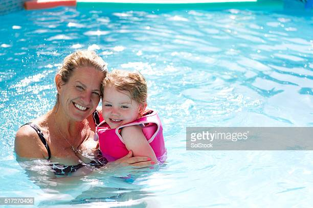 grandmother and grandaughter - kids pool games stock pictures, royalty-free photos & images