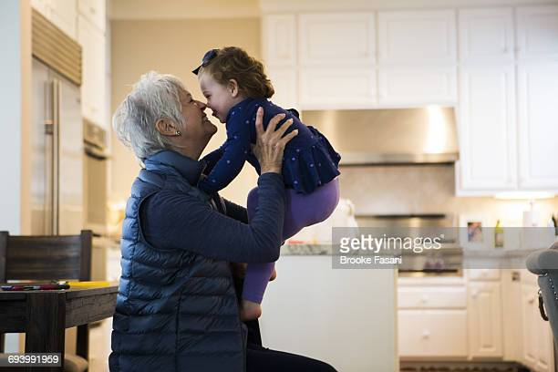 grandmother and grandaughter - kissing stock pictures, royalty-free photos & images