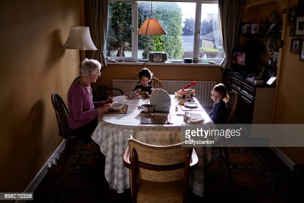 Grandmother And Grandchildren At Table