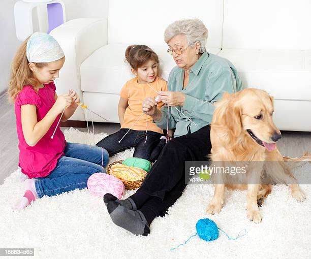 Grandmother and grandchildren knitting at home