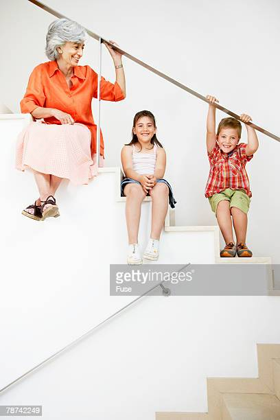 Grandmother and Grandchildren Sitting on Stairs