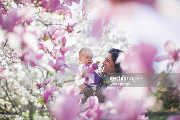 Grandmother and granddaughter amongst magnolia blossom