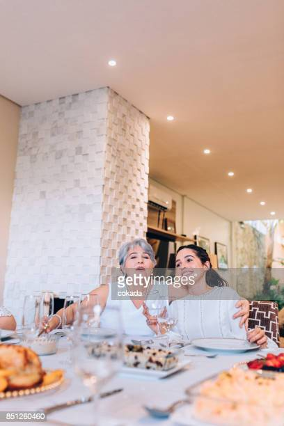 Grandmother and granddaughter at dining table