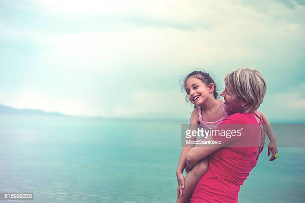 Grandmother And Granddaughter at the beach
