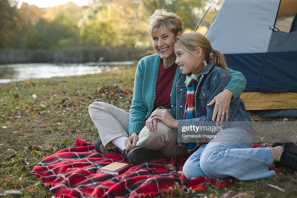 Grandmother and granddaughter camping : Stockfoto