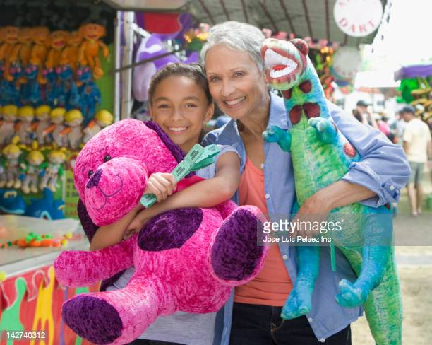 Grandmother and granddaughter enjoying amusement park