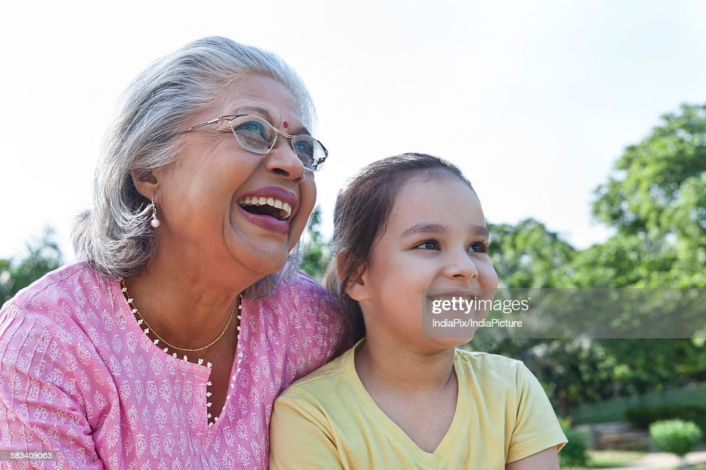 Grandmother and granddaughter enjoying : Stock Photo