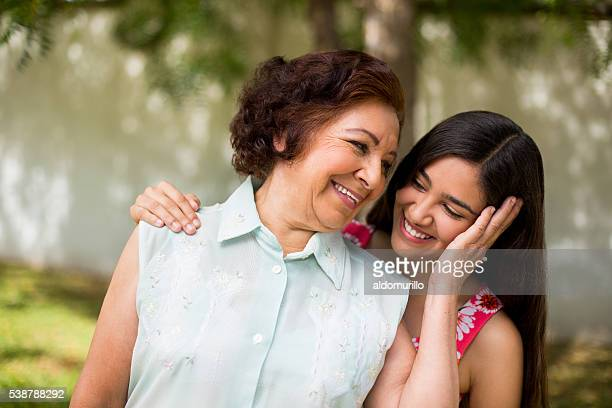 Grandmother and granddaughter holding each other dearly