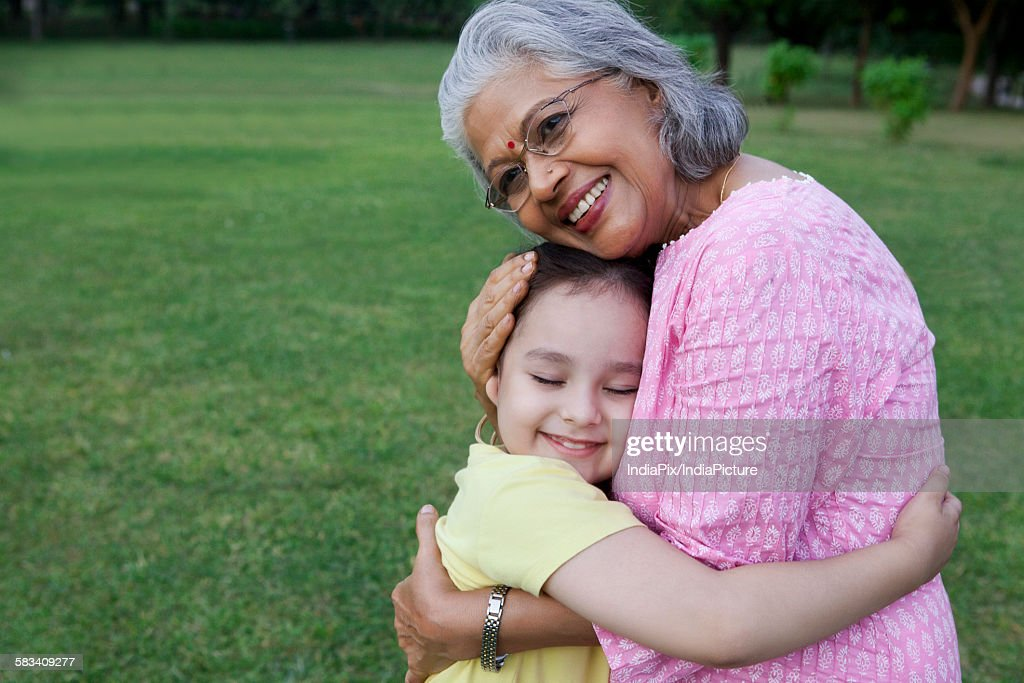 Grandmother and granddaughter hugging : Stock Photo