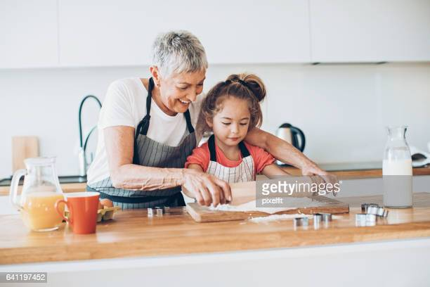 Grandmother and granddaughter in the kitchen