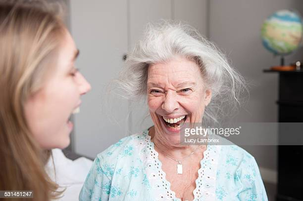 grandmother and granddaughter laughing out loud - grandmother stock pictures, royalty-free photos & images