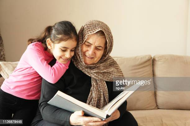 grandmother and granddaughter - turkey middle east stock pictures, royalty-free photos & images