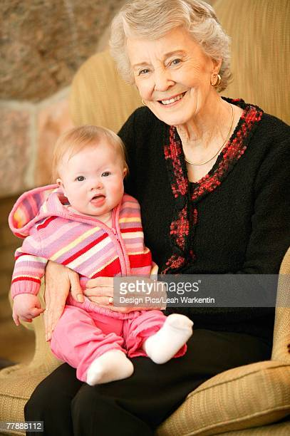 grandmother and granddaughter - great granddaughter stock photos and pictures