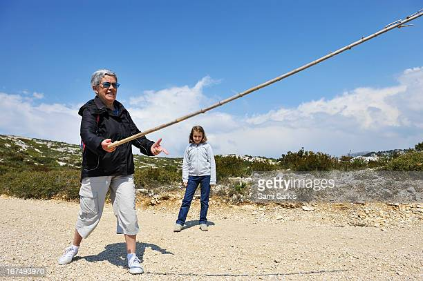 grandmother and granddaughter playing with stick - bouches du rhone stock pictures, royalty-free photos & images