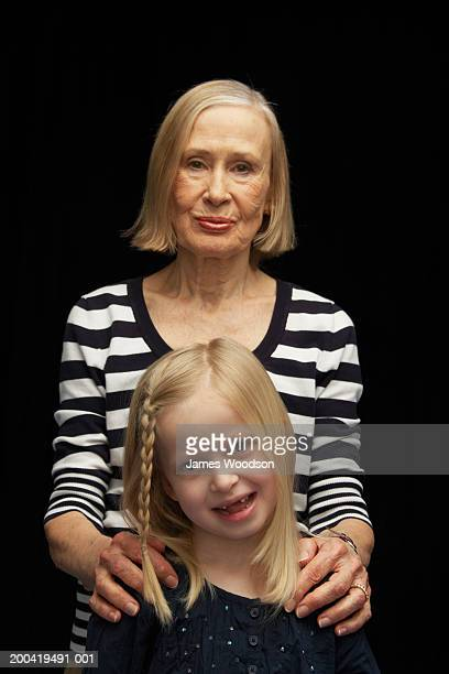 Grandmother and granddaughter (5-7) portrait, close-up