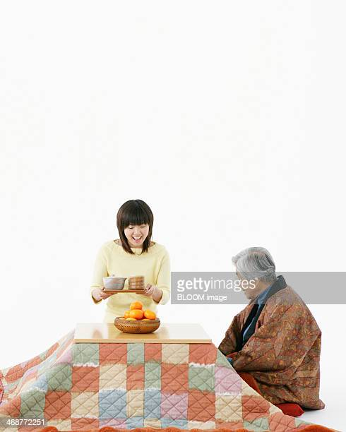 Grandmother And Granddaughter Sitting Together