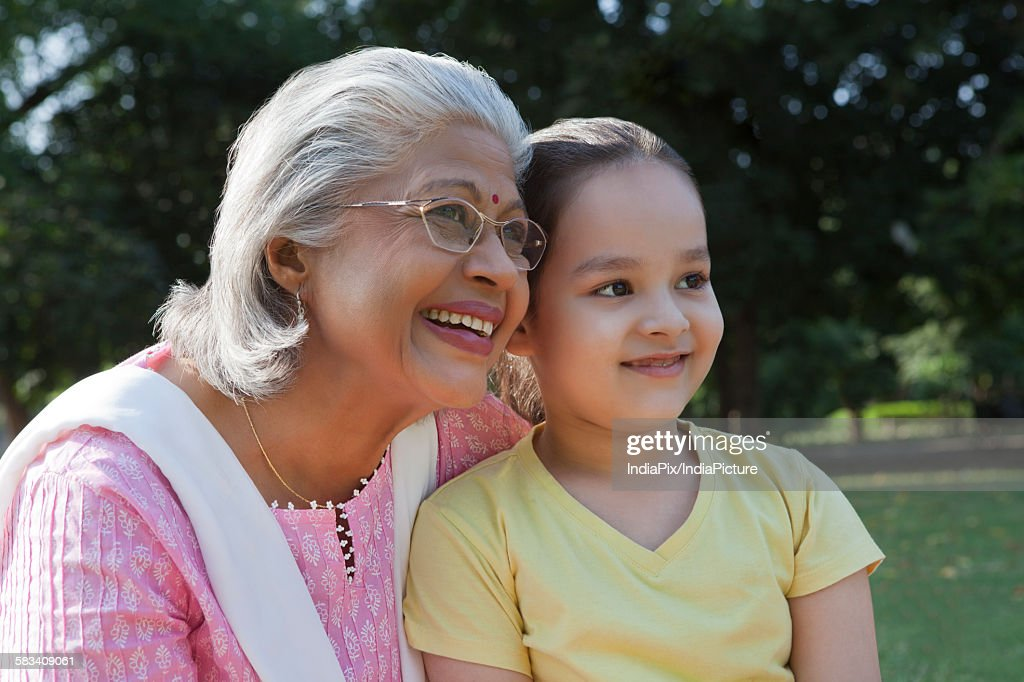 Grandmother and granddaughter smiling : Stock Photo