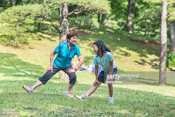 Grandmother and granddaughter stretching in Yoyogi park