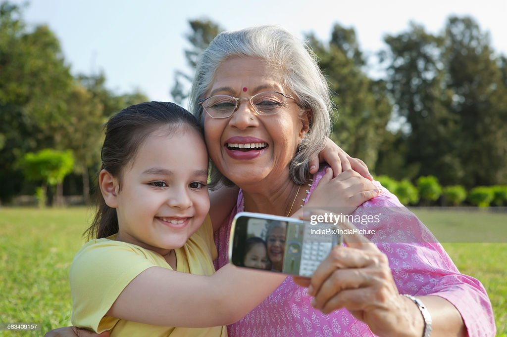 Grandmother and granddaughter taking a self portrait : Stock Photo