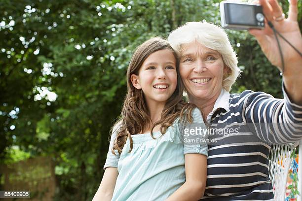 Grandmother and granddaughter taking self-portrait