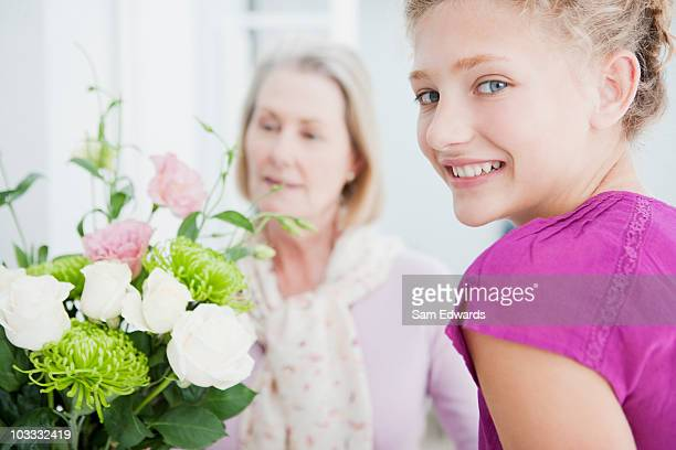 Grandmother and granddaughter with bouquet of flowers